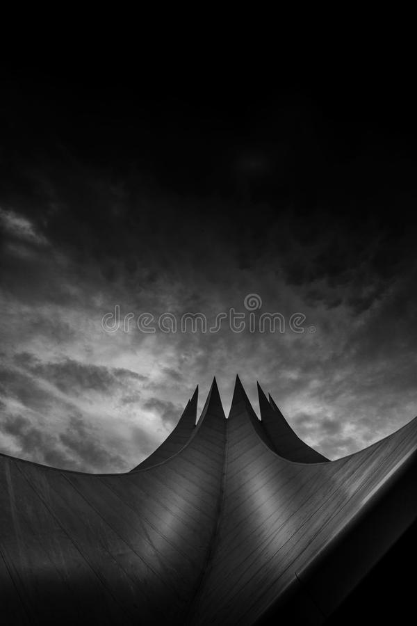 Greyscale Lowangle Photo Of Pointed Structure Under Cloudy Sky Free Public Domain Cc0 Image