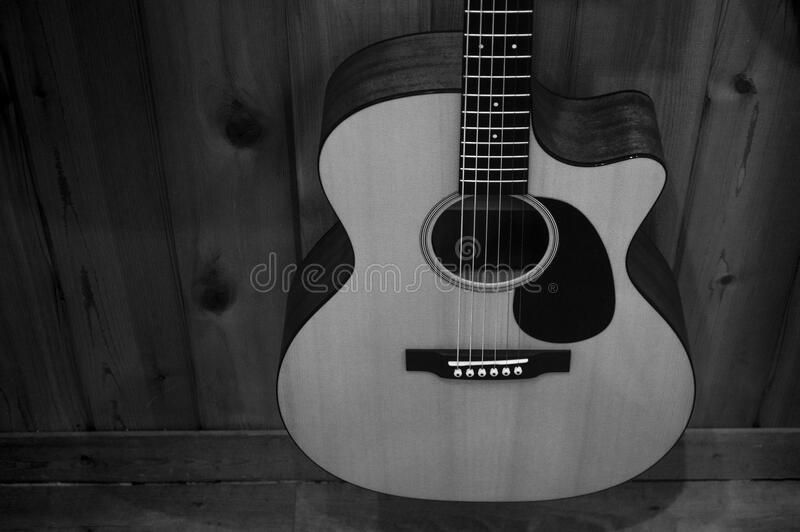Greyscale Photo Of Acoustic Guitar On Wooden Fence Free Public Domain Cc0 Image
