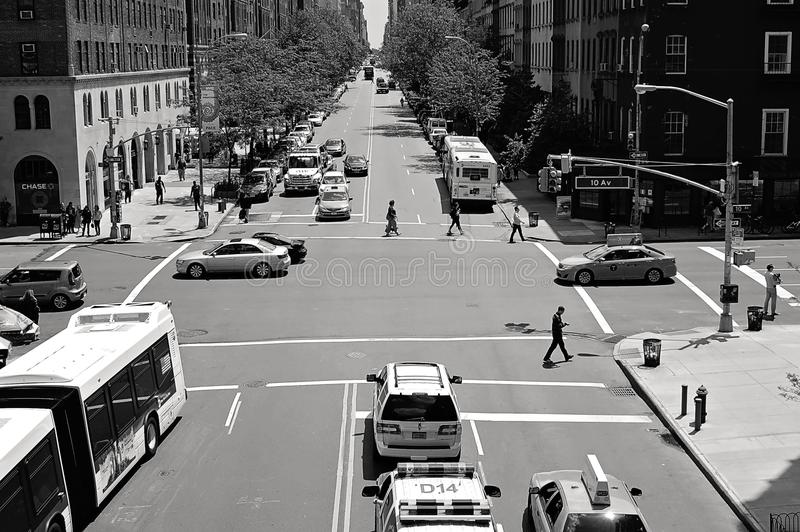 Greyscale Photo of Car and People on Streets stock images