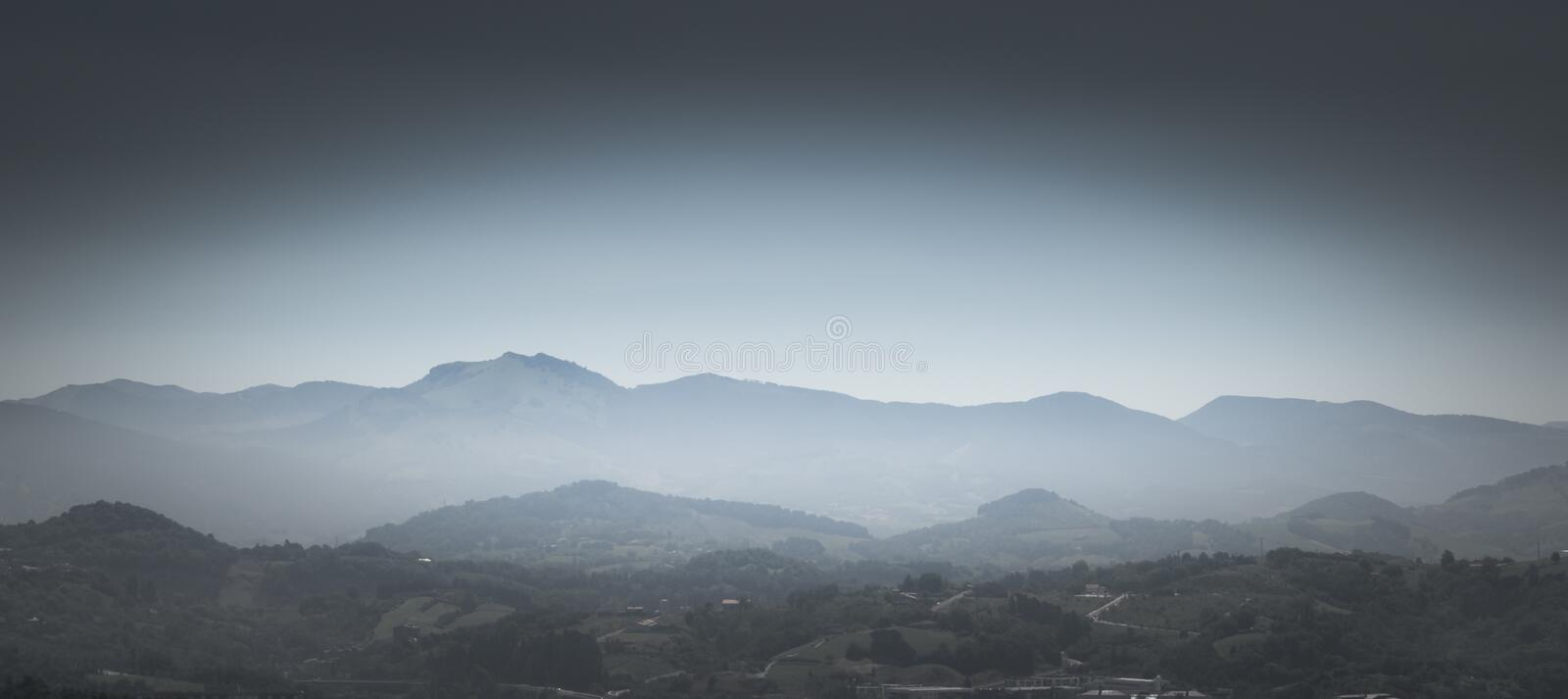 Greyscale Photo of Mountains With Mist royalty free stock photography