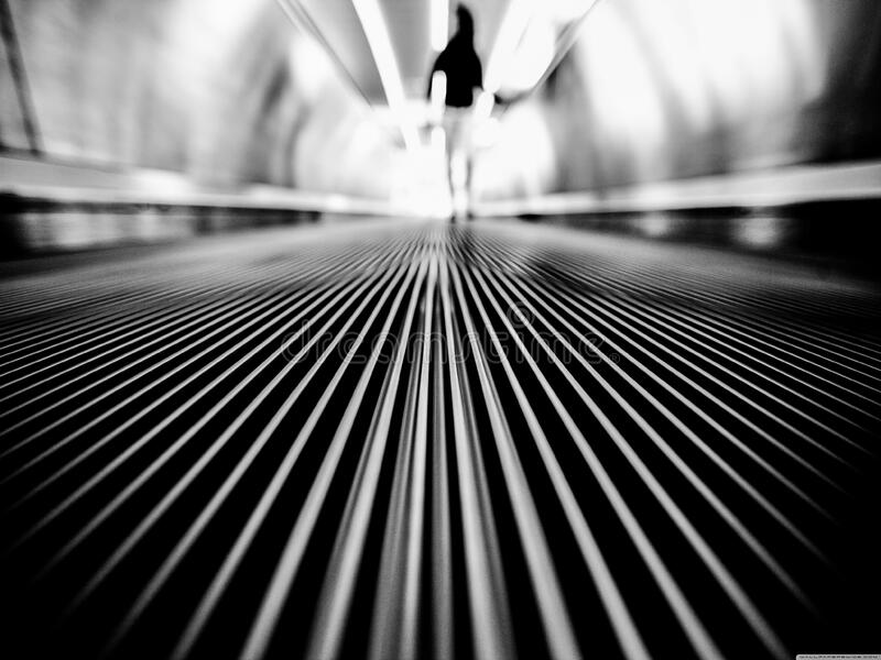 Greyscale Photography of Man Walking on Tunnel stock photo