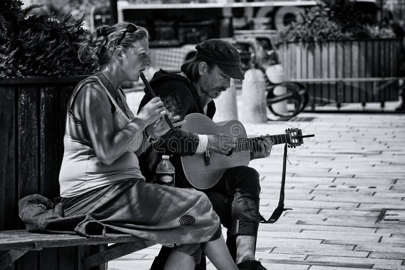 Greyscale Photography of Man and Woman Playing Musical Instruments stock image