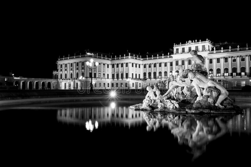 Greyscale shot of a statue in front of a historic building in Vienna, Austria. A greyscale shot of a statue in front of a historic building in Vienna, Austria royalty free stock photo