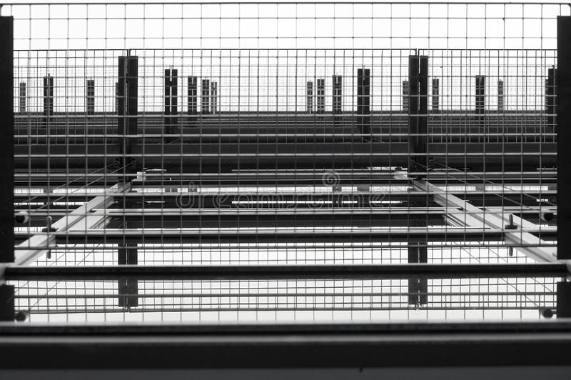Grid. The bottom view of a grid at a window facade royalty free stock photo