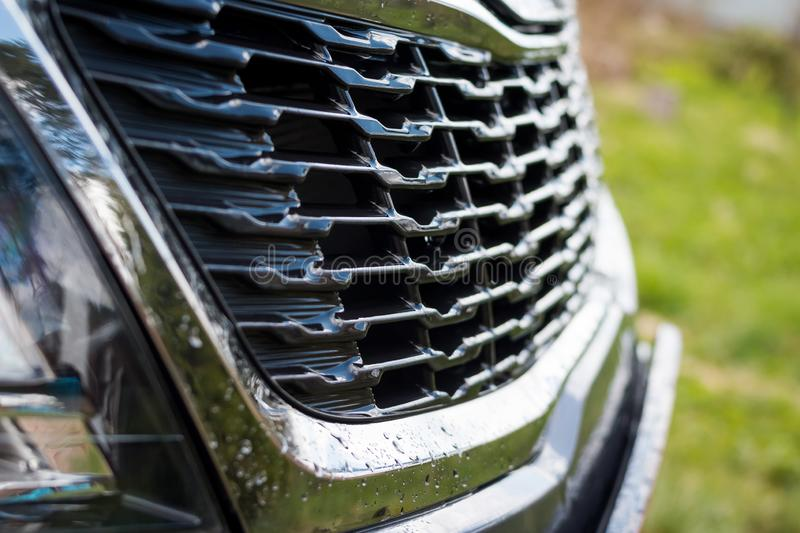 Grid of car. Radiator grille. Metal close-up texture background. Chrome grill of big powerful engine macro. Auto detail stock photos