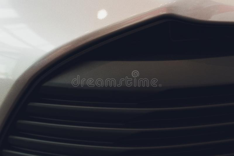 Grid of car with sunflare. Radiator grille. Metal close-up texture background. Chrome grill of big powerful engine macro royalty free stock images