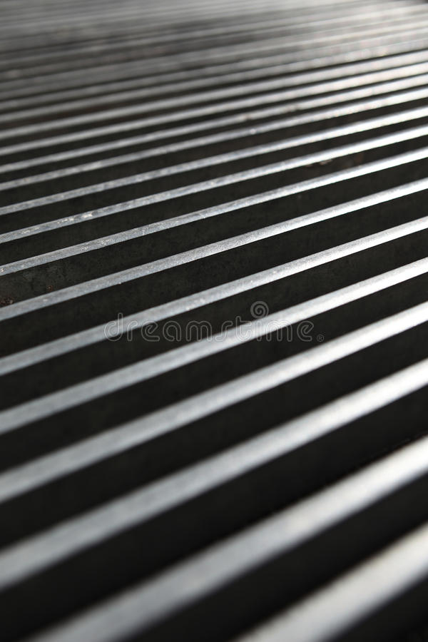 Grid manhole cover stock photography