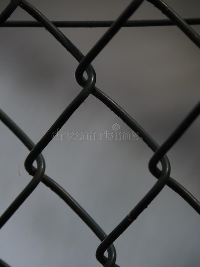 Steel grid to break. Grid means prison, jail. The sad colors give effectiveness to pic royalty free stock images