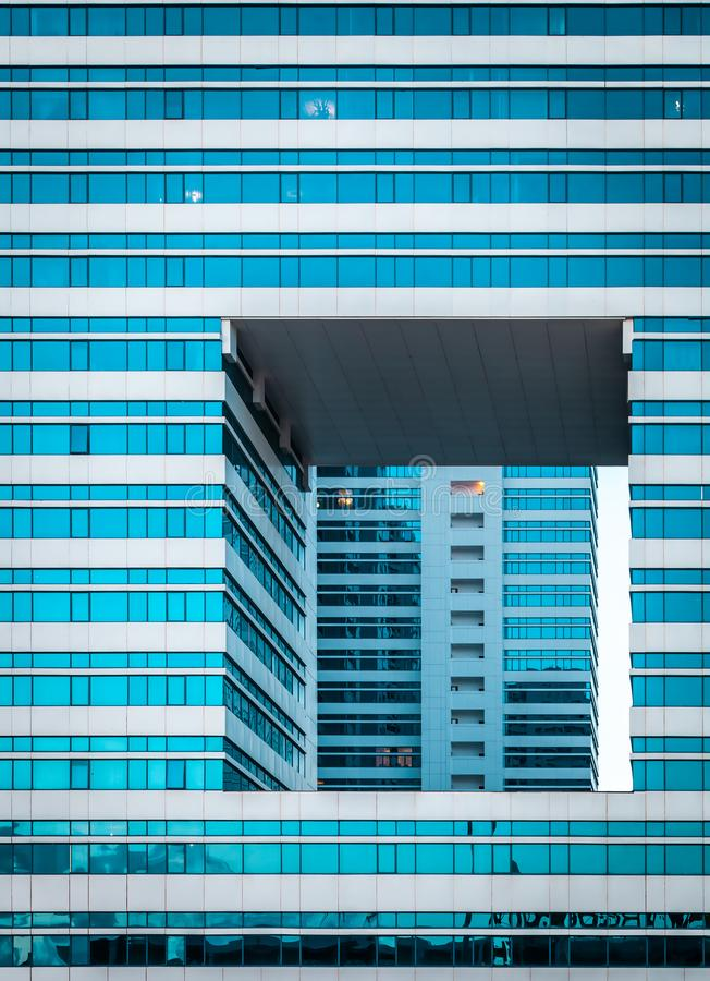 Grid of mirrored glass windows in modern business office building and reflection of exterior and windows of building stock photos