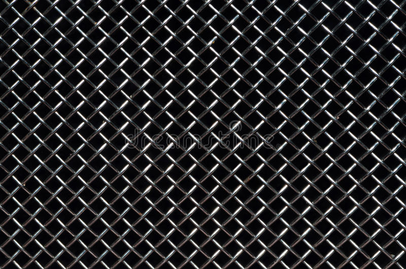 Grid. Nice gray steel grid over a black background stock images