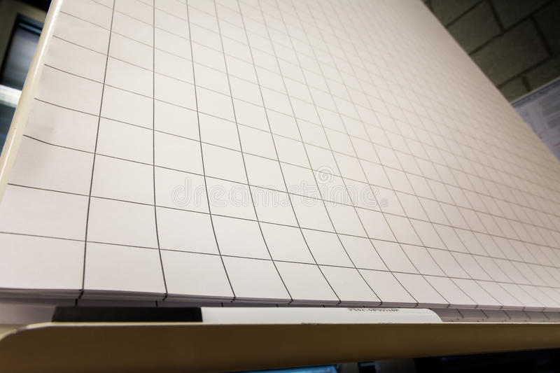 blank sheets of paper on black stock image