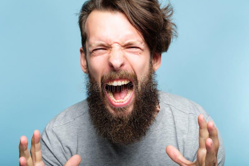 Grido infuriato dell'uomo di ripartizione emozionale di furia di rabbia immagini stock libere da diritti