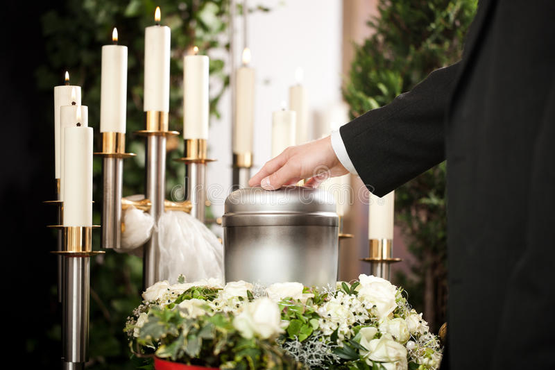 Grief - Funeral and cemetery. Religion, death and dolor - funeral and cemetery; urn funeral
