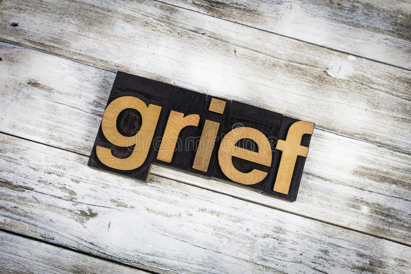 Grief Letterpress Word on Wooden Background. The word & x22;grief& x22; written in wooden letterpress type on a white washed old wooden boards background royalty free stock photos