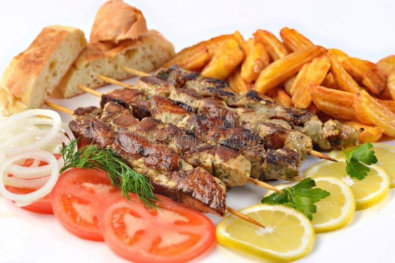 Griekse de sandwichongezonde kost van het souvlakivarkensvlees stock foto