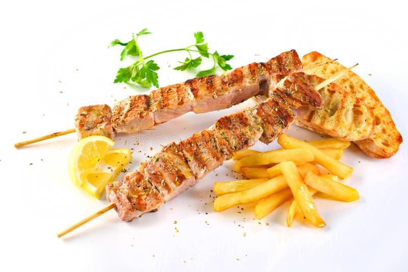 Griekse geroosterde kalamaki van de de sandwichongezonde kost van varkensvleessouvlaki stock foto