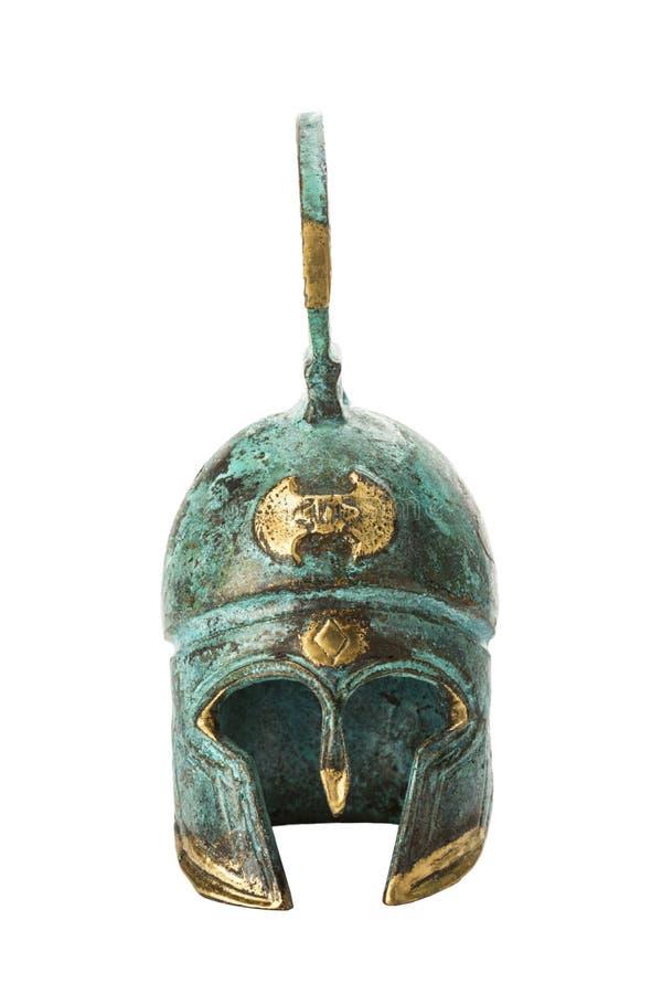 Griekse helm van het herinnerings de oude messing over wit royalty-vrije stock fotografie