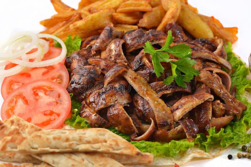 Griekse van de het gedeelteongezonde kost van varkensvleesgyroscopen het vleesmaaltijd stock fotografie