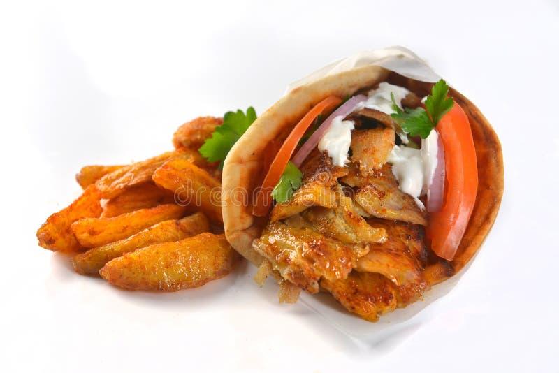 Griekse van de de sandwichongezonde kost van varkensvleesgyroscopen het vleesmaaltijd stock afbeelding