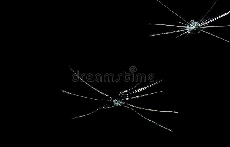 Grieta en fondo quebrado del negro del espejo de cristal imagen de archivo libre de regalías