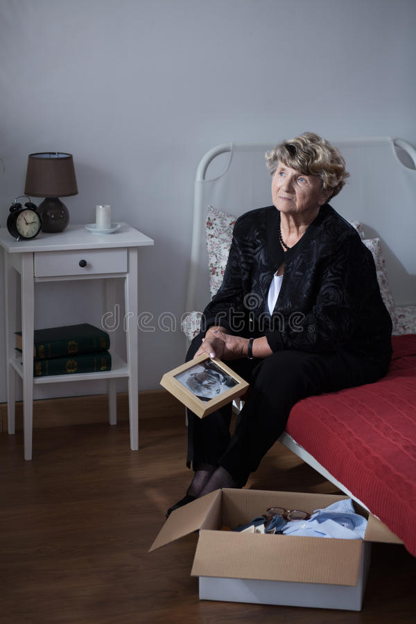 Grieving woman after funeral royalty free stock photo