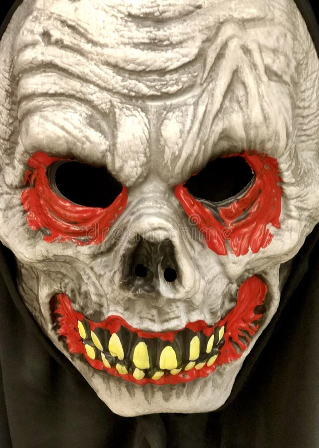 Griezelig lijkenetende geestmasker stock foto's