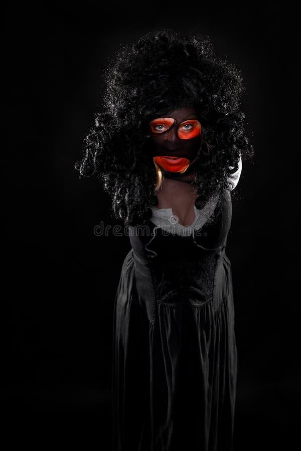Griezelige heks voor zwarte stock foto