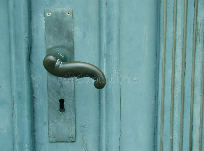 Griff auf grüner Tür stockbild