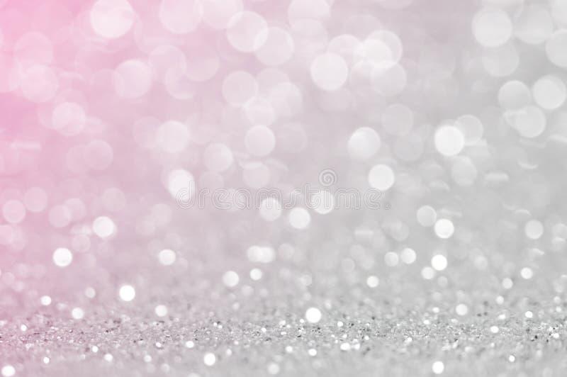 Grigio chiaro astratto, il colore de di rosa del nastro ha messo a fuoco il fondo circolare Luce notturna o fondo accogliente di  fotografia stock