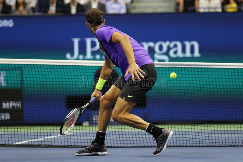 Grigor Dimitrov of Bulgaria in action during the 2019 US Open quarter-final match against 20-time Grand Slam champion Roger Federe royalty free stock photo