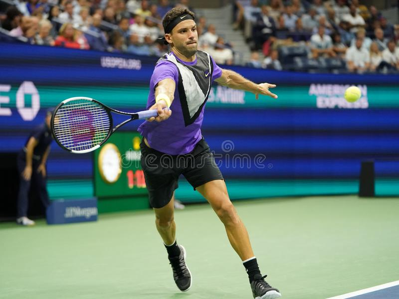 Grigor Dimitrov of Bulgaria in action during the 2019 US Open quarter-final match against 20-time Grand Slam champion Roger Federe stock photo