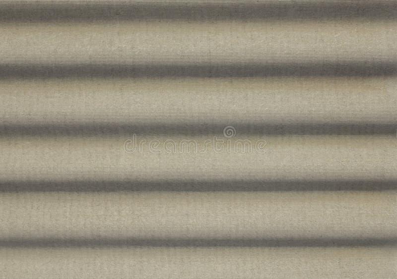 Grijs concreet schild met golvende hulp en schaduwen Horizontale lijnen Ruwe Oppervlaktetextuur royalty-vrije stock afbeelding