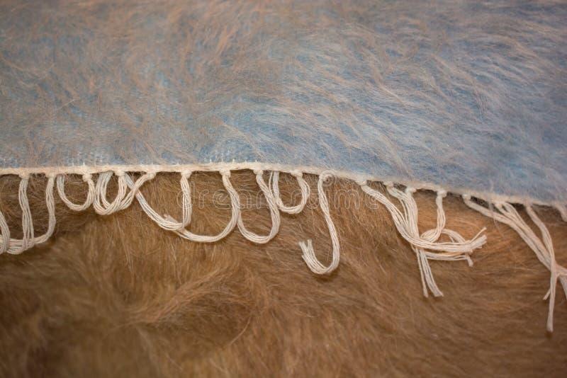 Grijs en blauw gevoeld als stof materiële het vormen zich textuurbackgrou royalty-vrije stock afbeeldingen