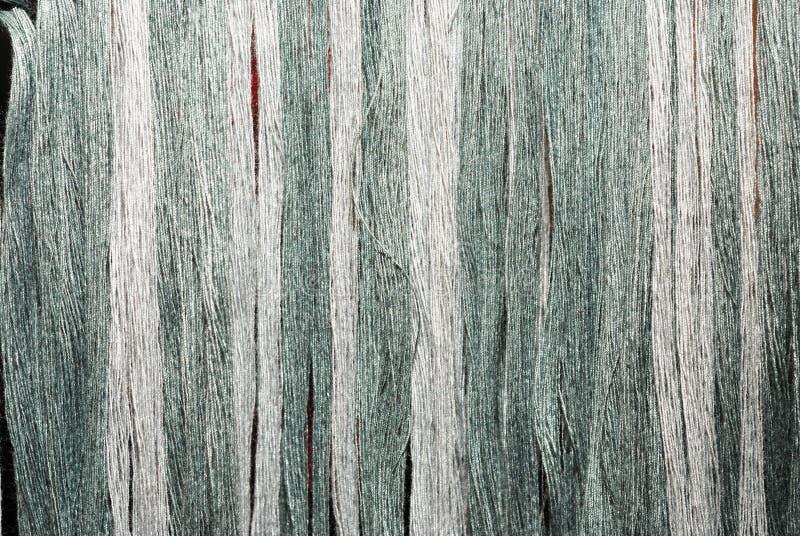 Grijs en de groene draad stock fotografie