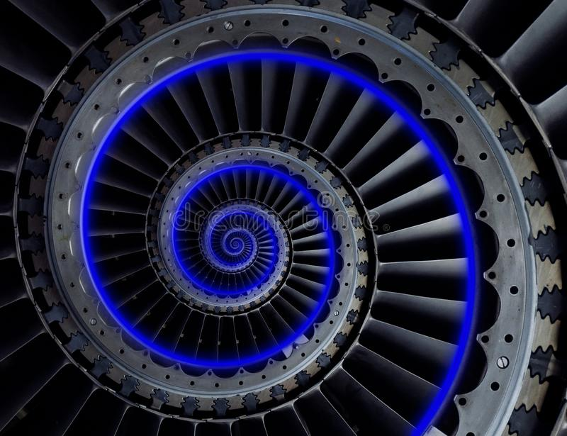 Grijs industrieel van de turbinebladen van de luchtambacht spiraalvormig patroon als achtergrond met de blauwe rol van de neonglo stock afbeelding