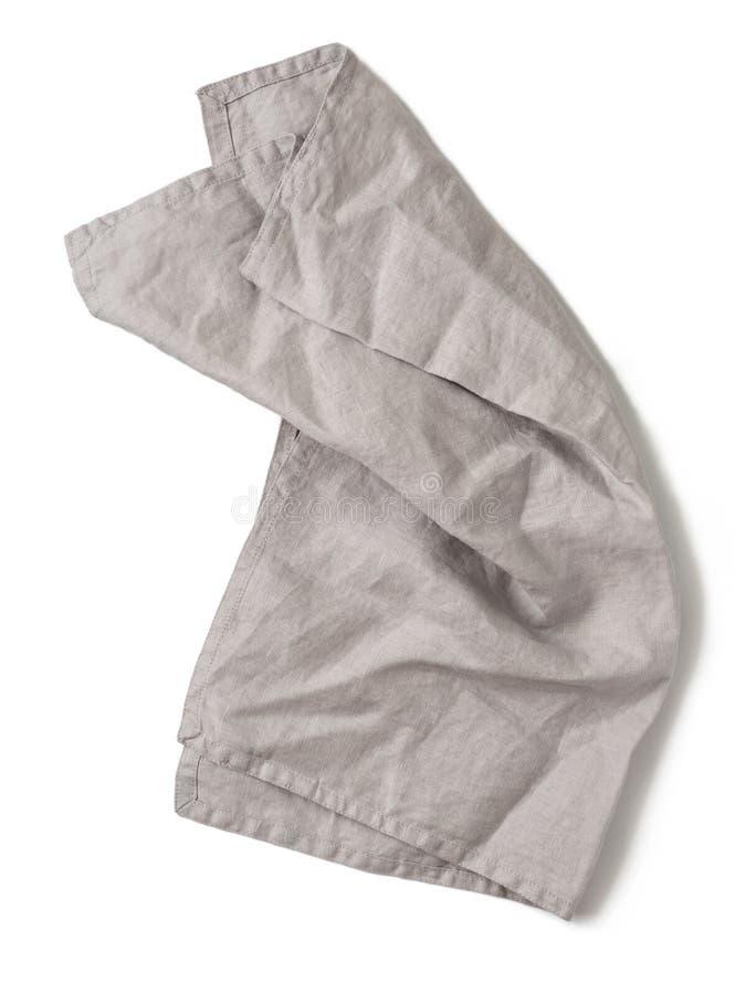 Grijs linnenservet op wit royalty-vrije stock afbeeldingen