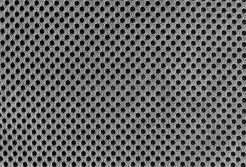 Grijs in te ademen poreus poriferous materiaal voor luchtventilatie met gaten Zwart-witte Sportkledings nylon textuur stock afbeelding