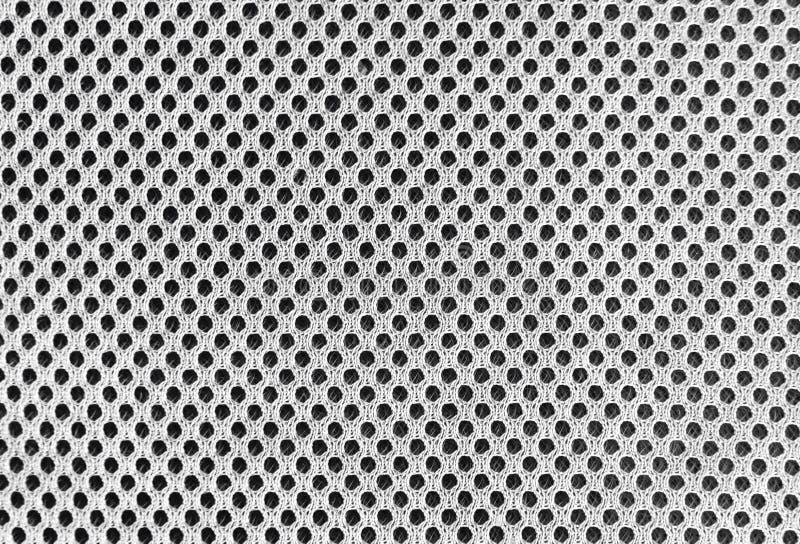Grijs in te ademen poreus poriferous materiaal voor luchtventilatie met gaten Zwarte witte Sportkledings nylon textuur royalty-vrije stock foto's
