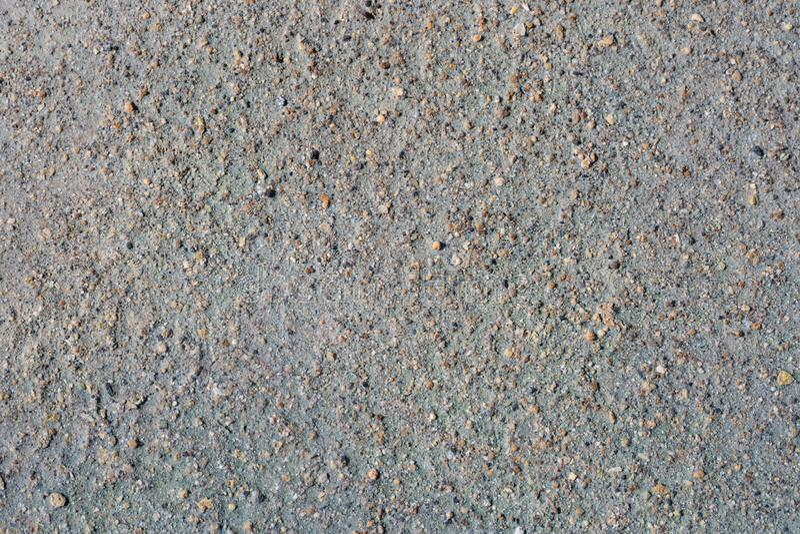 Grijs vulkanisch zand en kleine steenoppervlakte Gedetailleerde natuurlijke achtergrond of textuur royalty-vrije stock fotografie