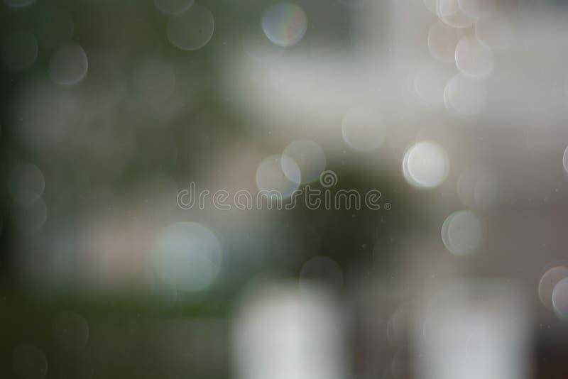 Grijze abstracte achtergrond met grote en kleine bokehcirkel stock afbeelding