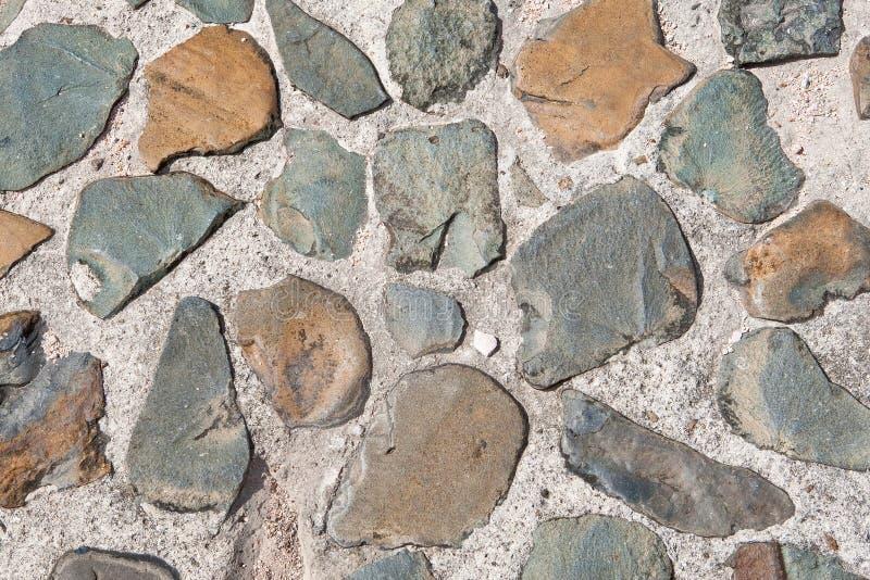 Grijze achtergrond van steenmuur stock foto