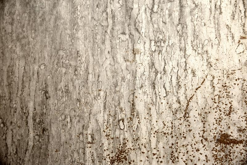 Grijze bevlekte achtergrond en roestige oppervlakte stock foto