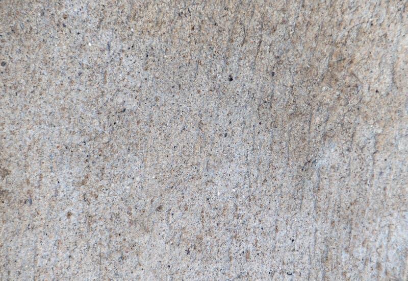 Grijze cementmuur als textuurachtergrond stock fotografie