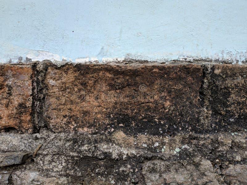 Grijze concrete muurtextuur en bakstenen muur stock afbeeldingen