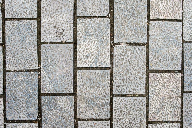 Grijze de textuurachtergrond van steentegels stock foto's