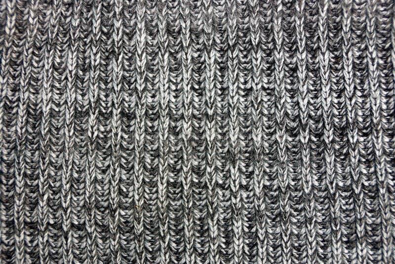 Grijze die textuur van een stuk van doek van wol wordt gemaakt royalty-vrije stock afbeelding