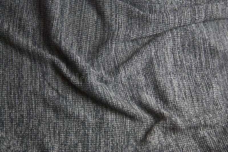 Grijze gebreide deken Zachte en warme stoffentextuur De ruimte van het exemplaar De herfst, dalings of de winterachtergrond stock afbeeldingen