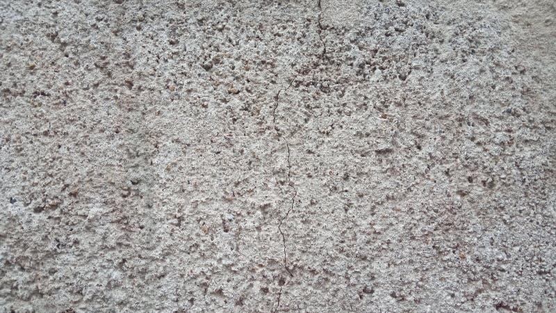 Grijze korrelige bouwachtergrond De oppervlakte van een concrete of geluchte het blokasfalt of een muur van het sintelcement royalty-vrije stock afbeelding