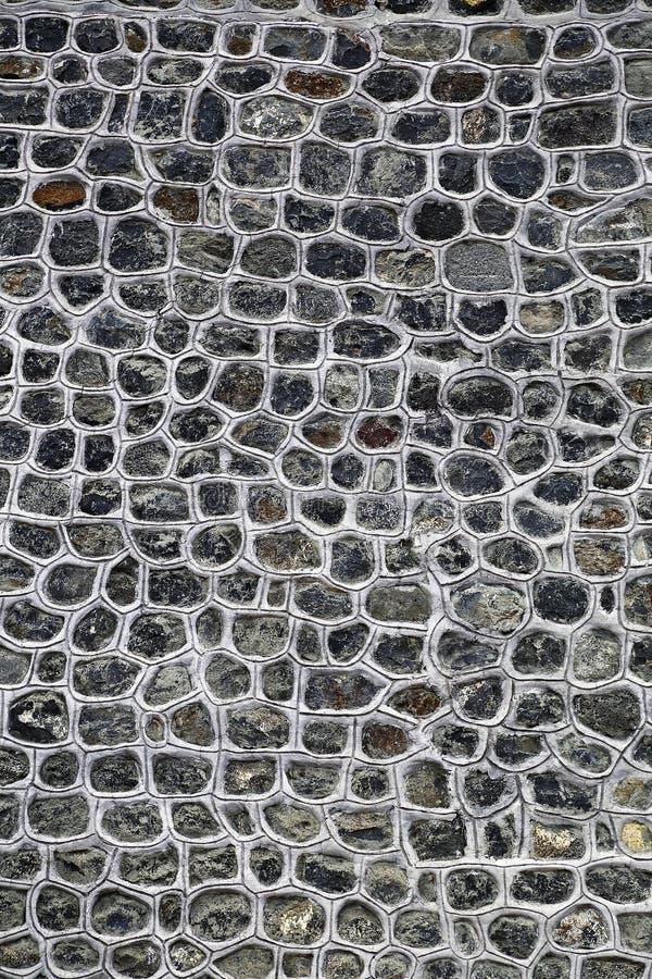 Grijze natuurlijke steenmuur royalty-vrije stock fotografie