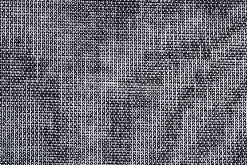 Grijze niet-geweven stoffenachtergrond stock afbeelding